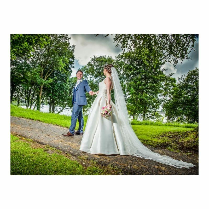 wedding photo of bride and groom walking
