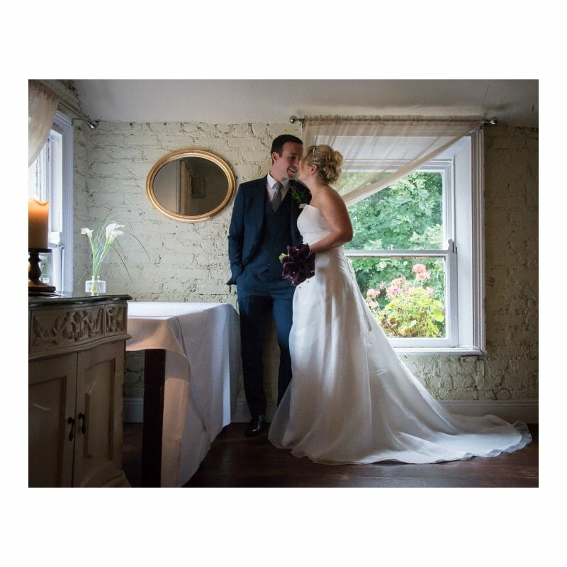 photo of bride and groom sharing a word